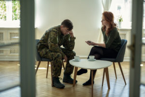 veteran in military uniform speaking with therapist
