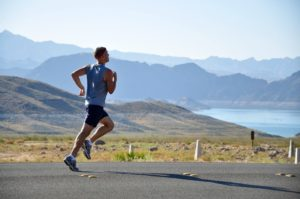 athlete running against a scenic mountain backdrop
